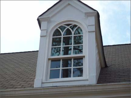What are the names of some replacement window manufacturers?
